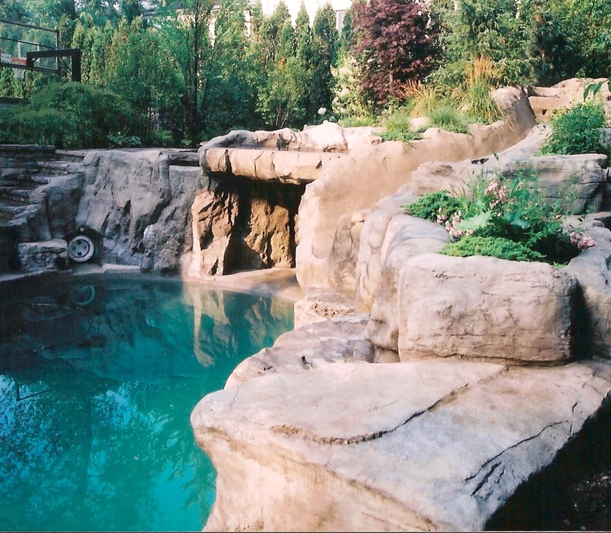 An Artificial Rock Grotto Waterfall Stairs And Slide Into The Custom Pool